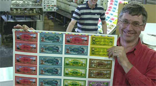 Wairarapa Green Dollar Exchange spokersperson Hayden McGrail shows off the new notes at Masterton printers Printcraft.